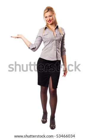 Attractive businesswoman in suit presenting an invisible product