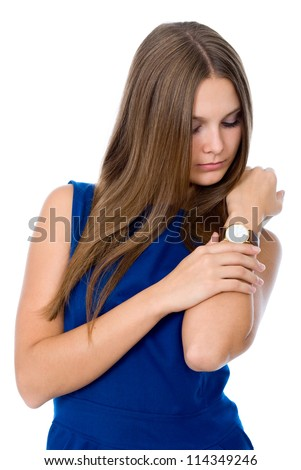 Attractive businesswoman looking at her watch isolated over a white background - stock photo