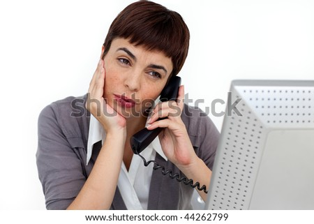 Attractive Businesswoman on phone at her desk against a white background - stock photo