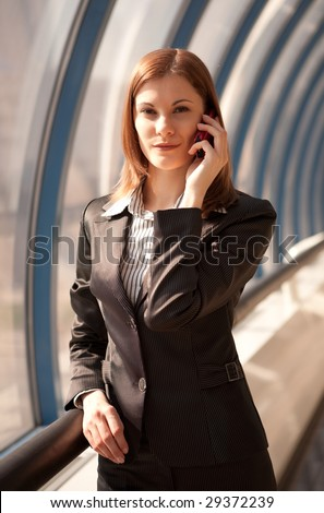 Attractive businesswoman talking on the phone