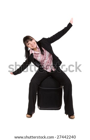 attractive businesswoman traveling with suitcase