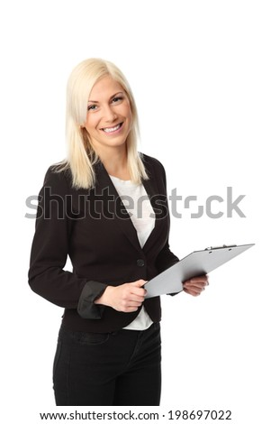 Attractive businesswoman wearing a suit and shirt, holding a clipboard. White background.