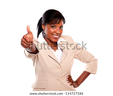 Attractive businesswoman with a winning attitude and lifting the fingers up against white background - stock photo