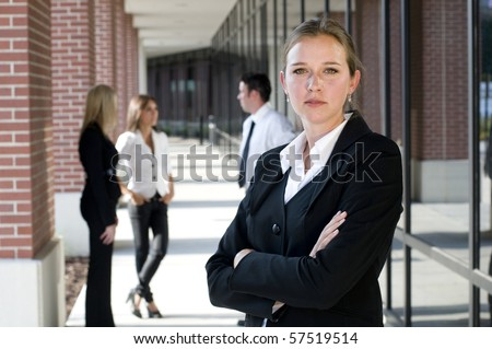 Attractive businesswoman with arms crossed looking at camera