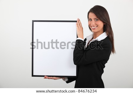 Attractive businesswoman with picture frame - stock photo