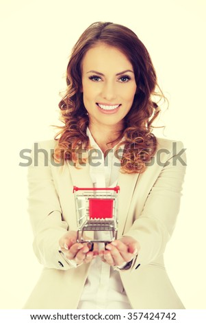 Attractive businesswoman with shopping cart. - stock photo
