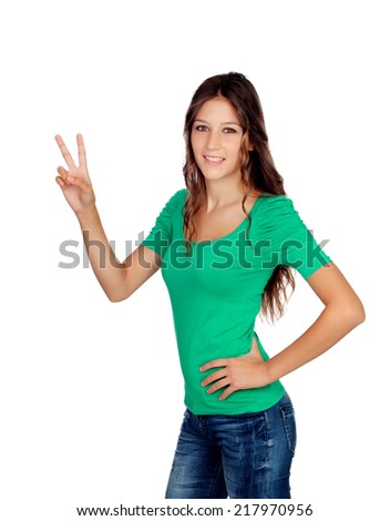 Attractive casual girl in green making the sign of victory isolated on white - stock photo