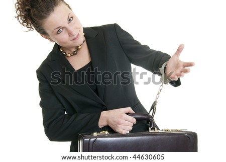 Attractive Caucasian business woman holding a briefcase while handcuffed to it. - stock photo