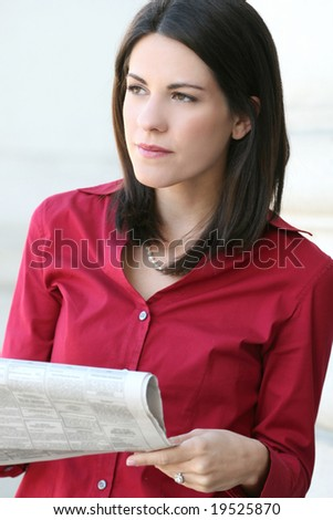Attractive Caucasian business woman reading a newspaper. Suitable for a variety of economic and political themes - stock photo