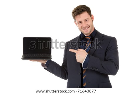 Attractive caucasian businessman showing a laptop and pointing at . Studio shot. White background. - stock photo