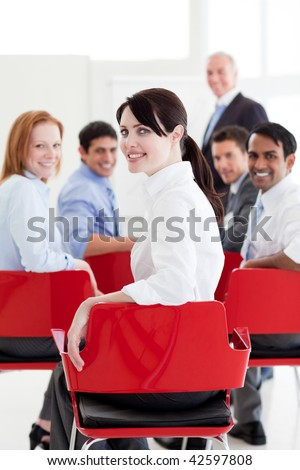 Attractive caucasian businesswoman at a conference smiling at the camera - stock photo