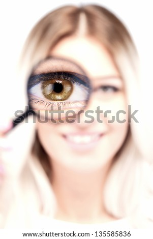 attractive caucasian girl with loupe on her eye