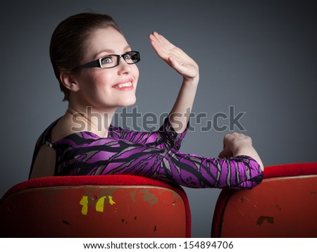 Attractive caucasian woman in the theatre in her 30 isolated on a grey background - stock photo