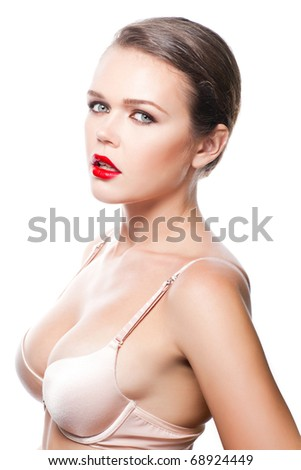 attractive caucasian woman wearing bra isolated on white background