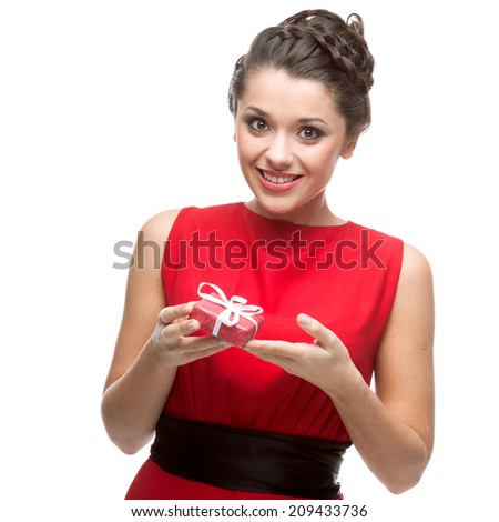 attractive cheerful caucasian young woman in red dress holding gift. isolated on white - stock photo