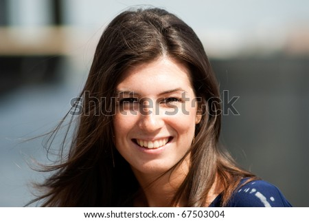 attractive cheerful freckles young woman portrait on a summer day