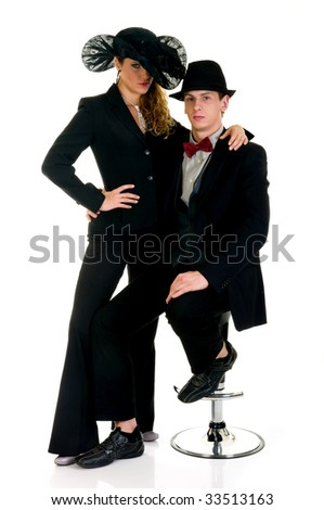 Attractive classy couple on bar stool. Studio, white background