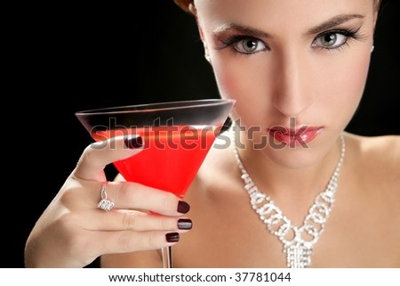 Attractive cocktail woman with jewelery and martini red glass