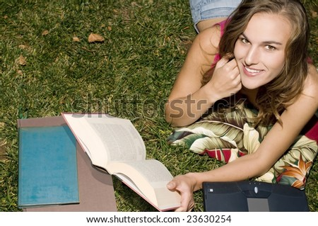 Attractive College Student Studying Outdoors.