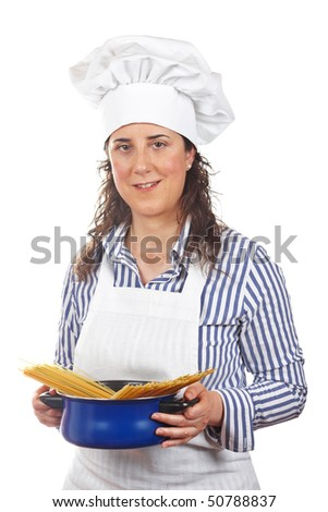 Attractive cook woman holding a blue pan with spaghetti uncooked - stock photo