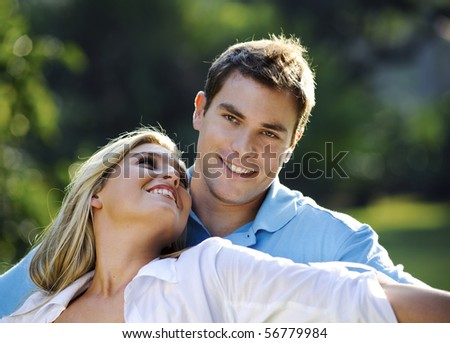Attractive couple are happy with each other in the park