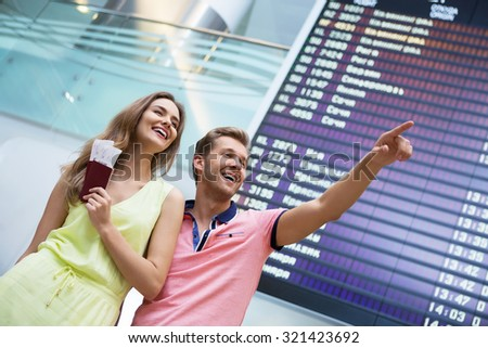 Attractive couple at board at the airport - stock photo