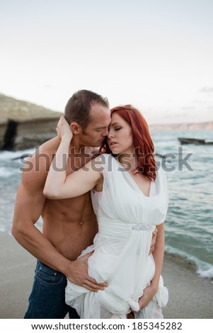Attractive Couple at the Beach - stock photo