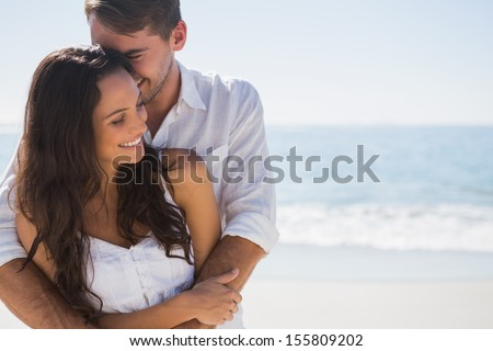 Attractive couple cuddling at the beach. Couple Hugging Stock Images  Royalty Free Images   Vectors