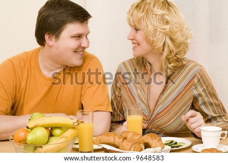Attractive couple have a breakfast at the table
