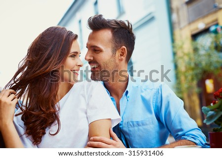 Attractive couple hugging in the city - stock photo