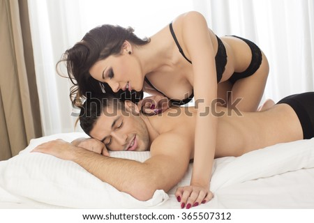 Attractive couple in bed