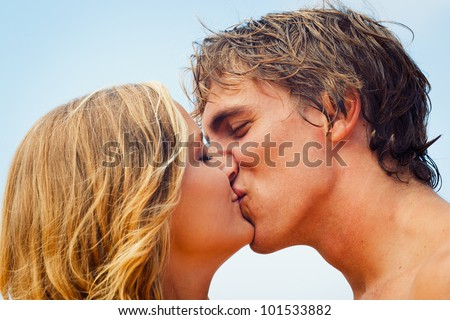 Attractive Couple Kissing on Beautiful Beach - stock photo