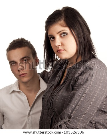 Attractive couple portrait. Elegant with serious expressions, isolated on white background - stock photo