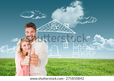 Attractive couple showing thumbs up to camera against blue sky over green field - stock photo