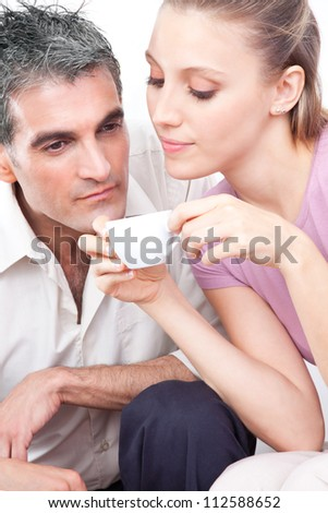 Attractive couple smelling cup of warm coffee