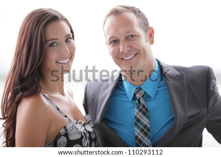 Attractive couple smiling - stock photo