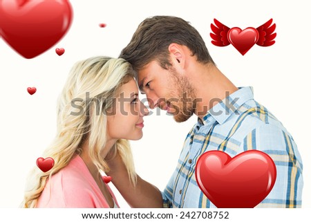 Attractive couple smiling at each other against hearts