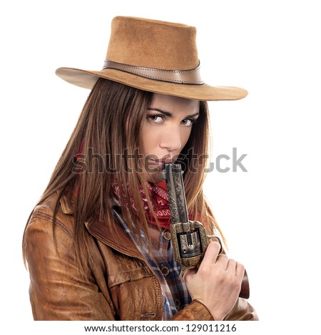 Attractive cowgirl with gun on white background - stock photo