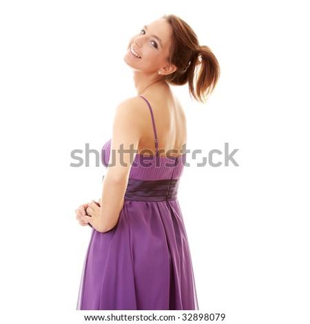Attractive dancer girl in violet classic dress, studio shot - stock photo