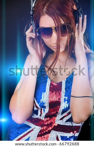 Attractive dancing girl with a headphone - stock photo