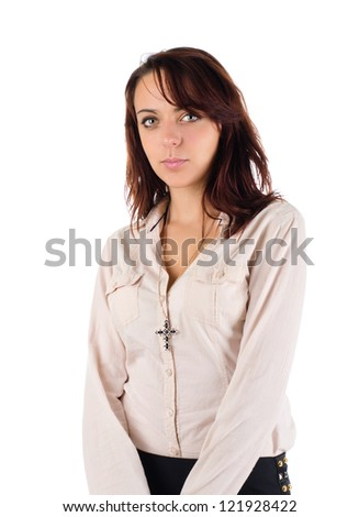 Attractive demure young woman with a serious expression standing with her arms clasped in front of her isolated on white