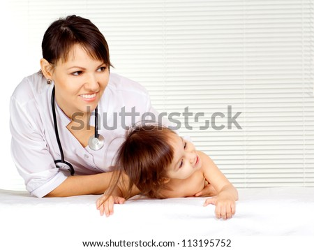 Attractive doctor takes in his study a small patient - stock photo