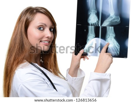 Attractive doctor with x-ray in hand over a white background - stock photo