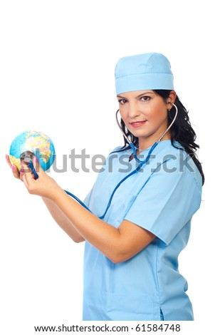 Attractive doctor woman standing in semi profile and examine a  world globe with her stethoscope isolated on white background
