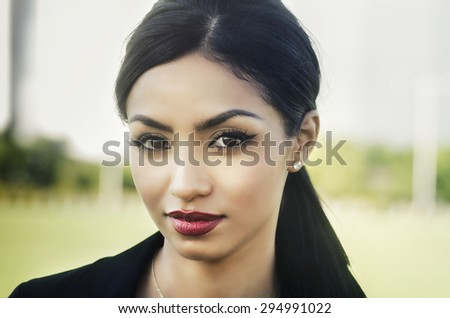 Attractive elegant young woman - stock photo