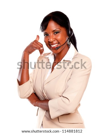 Attractive ethnic receptionist wearing headset while saying at you call me against white background - stock photo