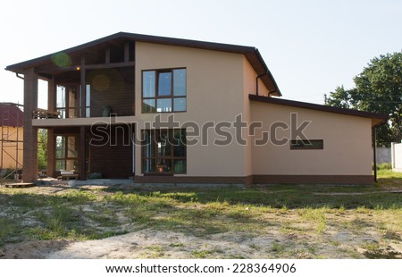 Attractive Exterior Design of Architectural Real Estate Model House on Grassy Landscape. - stock photo