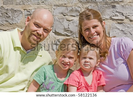Attractive Family of Four - stock photo