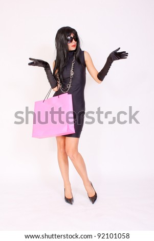 Attractive Fashion Girl Wearing Sunglasses Into Shopping Euphoria - stock photo