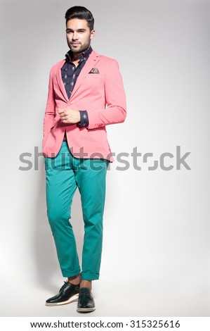 attractive fashion male model dressed elegant - casual posing against